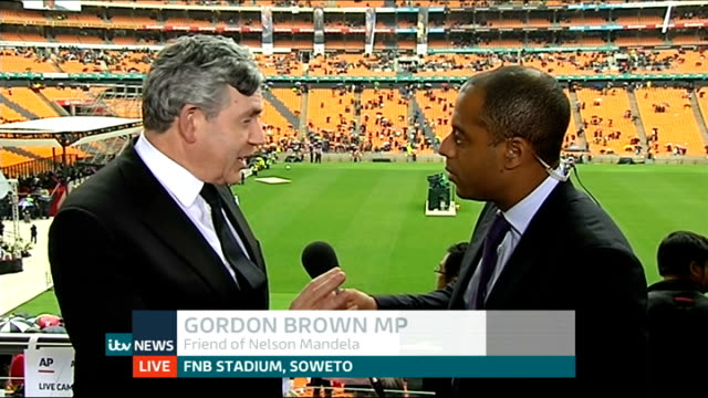 nelson mandela death memorial service held gordon brown mp live interview sot - memorial event stock videos and b-roll footage