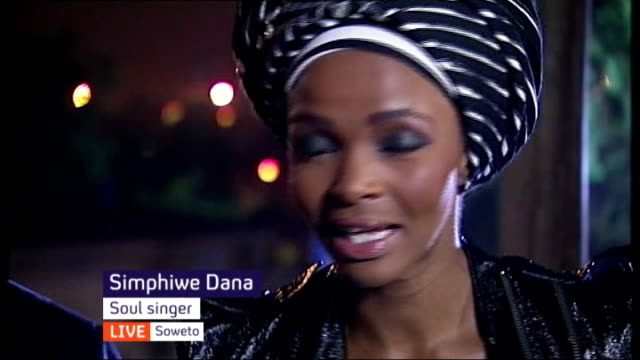 nelson mandela death memorial service held live south africa johannesburg soweto ext / night tony kgoroge and simphiwe dana interview sot - memorial event stock videos and b-roll footage