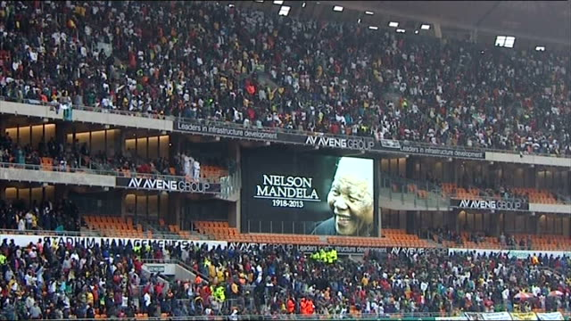 nelson mandela death memorial service held 'nelson mandela 1918 2013' sign in crowd - memorial event stock videos & royalty-free footage