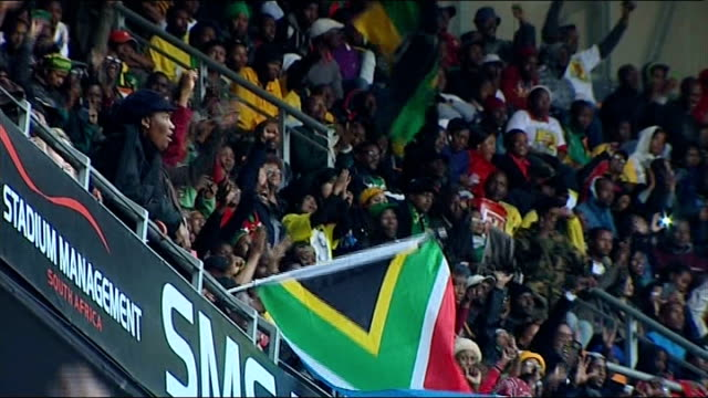 nelson mandela death memorial service held people in stands cheering and waving flags - memorial stock videos & royalty-free footage