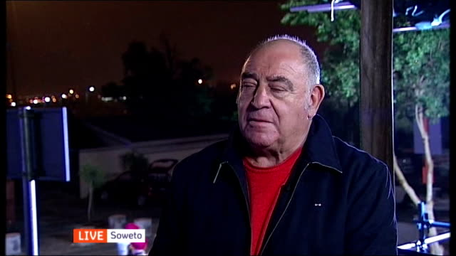 nelson mandela death memorial service held south afria johannesburg soweto ext / night ronnie kasrils live interview sot - soweto stock videos and b-roll footage
