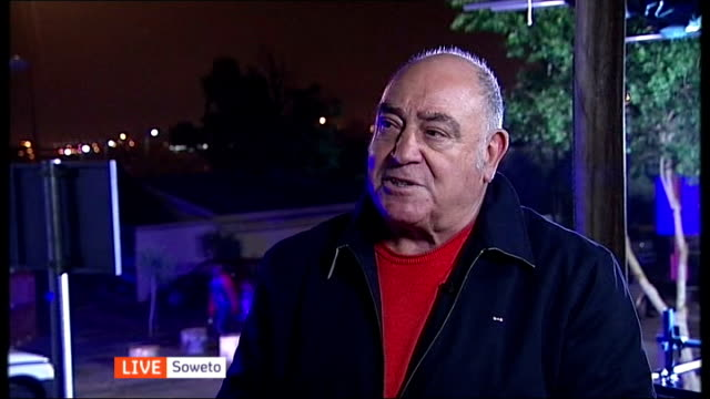 nelson mandela death memorial service held soweto ext / night ronnie kasrils live interview sot - memorial event stock videos and b-roll footage