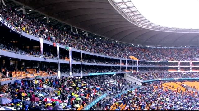 nelson mandela death memorial service held wide shot of crowds in stands at mandela memorial service close shot of large nelson mandela banner... - memorial stock videos & royalty-free footage