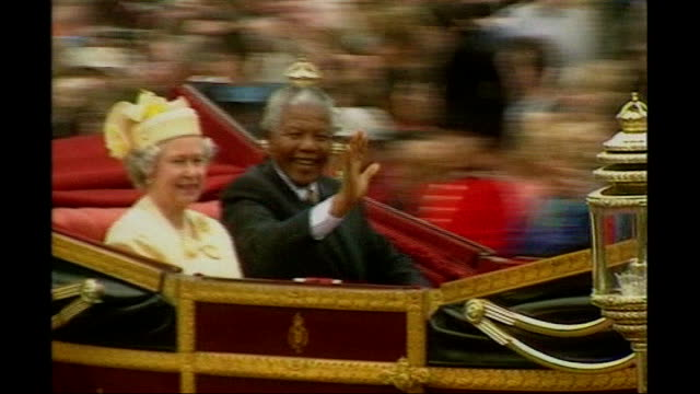 Nelson Mandela death Obit Life and Legacy File / 961996 / BSP090796011 ENGLAND London Nelson Mandela waving from open carriage as sitting alongside...