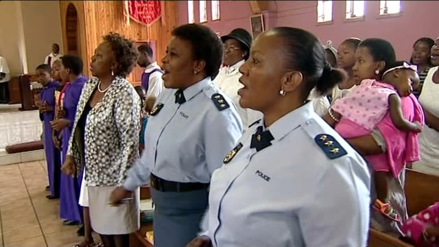 nelson mandela death remembrances held around the country soweto people singing in church people including women police officers singing location... - religious service stock videos & royalty-free footage