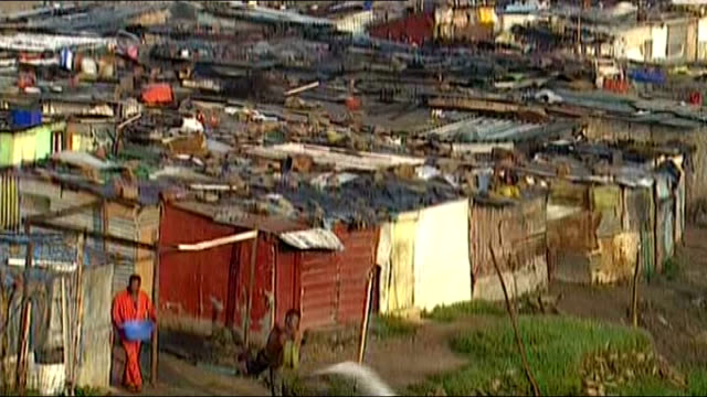 nelson mandela death revisiting one of johannesburg's poorest townships alexandra bsp220294029 / people and vehciles along road shanty houses in... - makeshift stock videos and b-roll footage