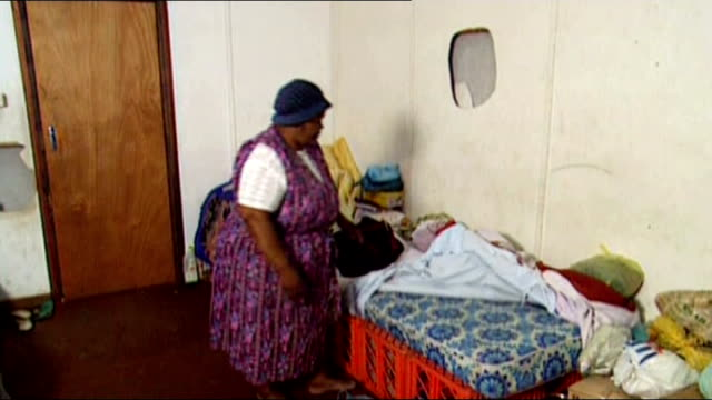 nelson mandela death revisiting one of johannesburg's poorest townships alexandra bsp220294029 / int lettie mahlupe in makeshift bedroom ruins of... - makeshift stock videos and b-roll footage