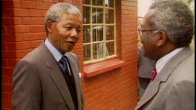 Nelson Mandela death Sir Trevor McDonald tribute 1221990 / T12029001 Nelson Mandela and his wife Winnie Mandela along through garden together both...