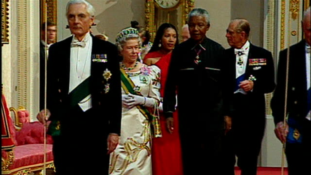 nelson mandela death sir trevor mcdonald tribute 971996 / t09079604 england london buckingham palace nelson mandela along with queen elizabeth as... - 1996 stock videos and b-roll footage