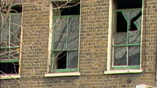 UK reaction 1431982 / AS131082007 Islington Various of London offices of ANC following bomb attack smahsed windows of offices and police officers...