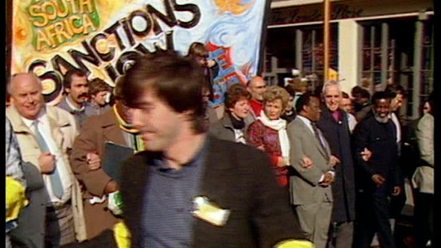 uk reaction 1987 / as241087011 various antiapartheid demonstrators marching along with placards calling for boycott of south african goods - 1987 stock videos & royalty-free footage
