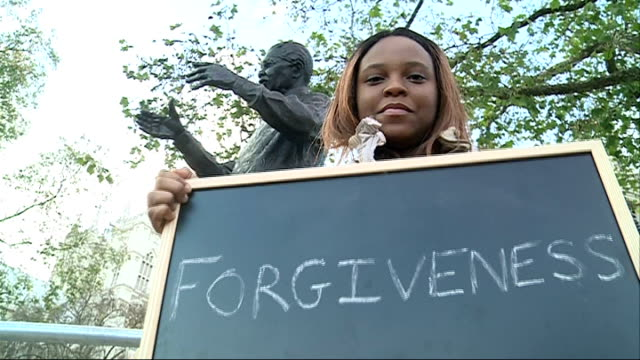 uk reaction england london young black woman holds up small blackboard with word 'forgiveness' written on it and sound overlay of her thoughts about... - forgiveness stock videos and b-roll footage