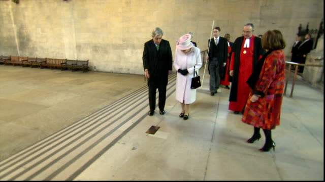 UK reaction Houses of Parliament Westminster Hall INT Queen Elizabeth accompanied by Commons SPeaker John Bercow MP stops of plaque on steps of...