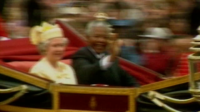 nelson mandela dies obit 961996 / bsp090796011 england london nelson mandela waving from open carriage as sitting alongside queen elizabeth - 1996 stock videos and b-roll footage