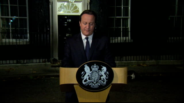 nelson mandela dies: reaction; england: london: downing street: ext / night david cameron mp statement in downing street sot - tonight one of the... - altruismo video stock e b–roll