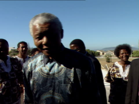 nelson mandela greeting youth choir with us first lady hillary clinton nelson mandela visits his old prison cell on robben island nelson mandela was... - nelson mandela stock videos and b-roll footage