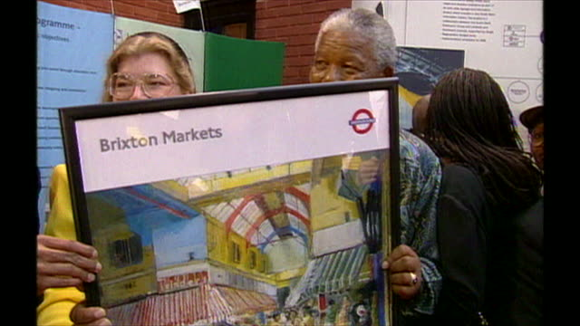 nelson mandela holding a poster and signing books on a visit to brixton - poster stock videos & royalty-free footage