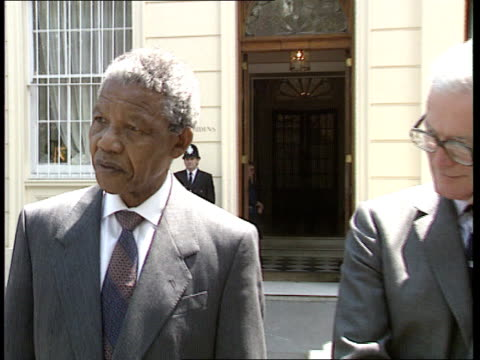 Nelson Mandela London visit ENGLAND London Mandela out of car amp greeted by David Steel former Liberal Leader amp Paddy Ashdown Liberal Democrats...