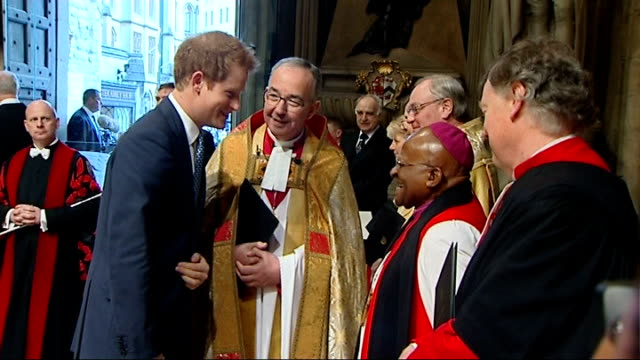 Nelson Mandela memorial service at Westminster Abbey arrivals Prince Harry arriving / Harry shaking hands with clergy including Desmond Tutu / Harry...