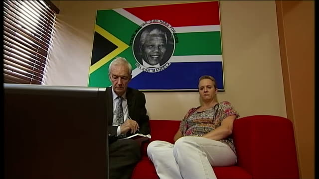 nelson mandela memorial service 'fake' sign language interpreter johannesburg int ingrid parkin and reporter watching television - memorial event stock videos and b-roll footage