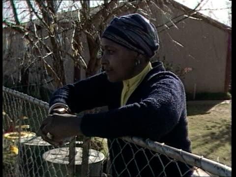 Nelson Mandela Orange Free State Brandfort GV Brandford Town PAN town LR CMS Winnie at garden fence MS Winnie and reporter Mike Hanna CMS WINNIE...