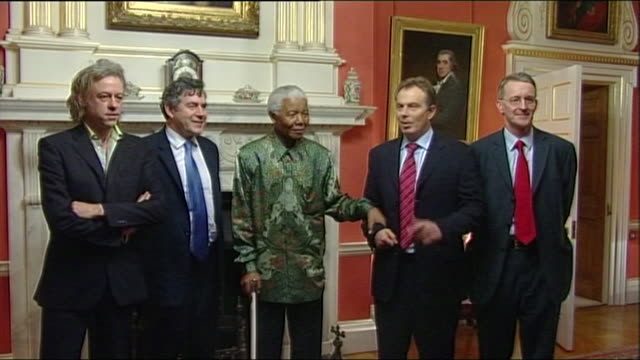 nelson mandela posing for a photograph with prime minister tony blair gordon brown bob geldof and hilary benn on a visit to downing street - bob geldof stock videos & royalty-free footage