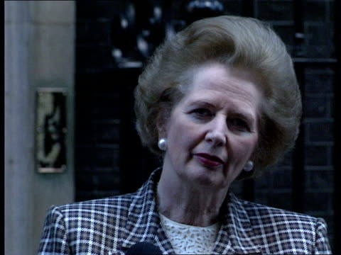 reactions prime minister margaret thatcher outside no 10 at mikes thatcher comments on changes announced in s africa by president f w de klerk... - releasing stock videos and b-roll footage
