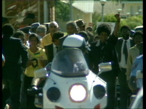 nelson mandela released from prison more of nelson and winnie walking free from prison police vehicles and onlookers in foreground partly obscuring... - releasing stock videos & royalty-free footage