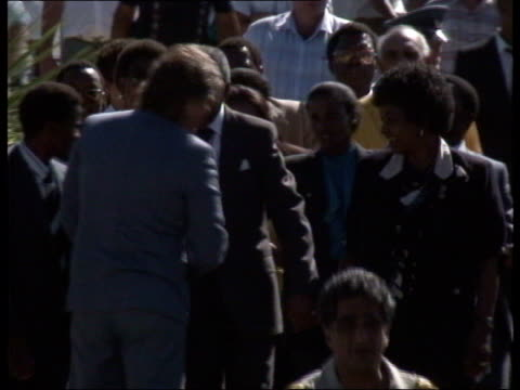 nelson mandela released from prison nelson mandela walking towards holding hands with his wife winnie mandela surrounded by security guards and well... - releasing stock videos and b-roll footage