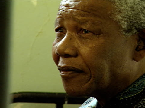 nelson mandela sitting in his cell nelson mandela visits his old prison cell on robben island nelson mandela was imprisoned on robben island for18... - prison icon stock videos & royalty-free footage