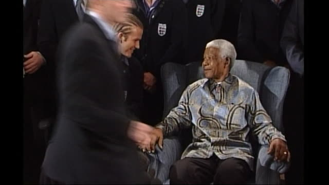 nelson mandela speaking to david beckham before a photoshoot with the england football squad - football team stock videos & royalty-free footage