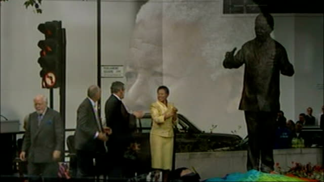vídeos de stock, filmes e b-roll de nelson mandela statue in parliament square widow of sculptor talks of its creation t29080722 statue of mandela being unveiled by then prime minister... - widow