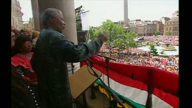 nelson mandela telling crowds in trafalgar square i wish i had big pockets so i could put all of you in them and take you back to south africa - love emotion stock videos & royalty-free footage