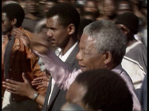 nelson mandela visits boipatong itn boipatong ext tlms nelson mandela among press others towards cms side mandela pan lr to woman tms mandela with... - nelson mandela stock videos and b-roll footage