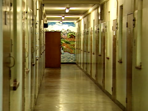 Nelson Mandela visits his old prison cell on Robben Island Nelson Mandela was imprisoned on Robben Island for18 years and went on to become the first...