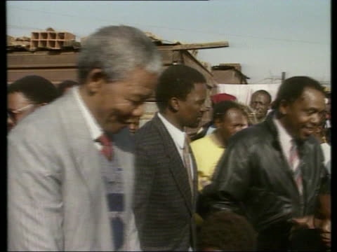 nelson mandela walks through crowds at squatter park shaking hands with children - nelson mandela stock videos and b-roll footage