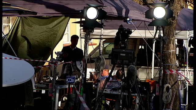 nelson mandela's condition improves; ext media crew with lights and cameras next to vehicles media presenter doing piece to camera media tent with... - hand on heart stock videos & royalty-free footage