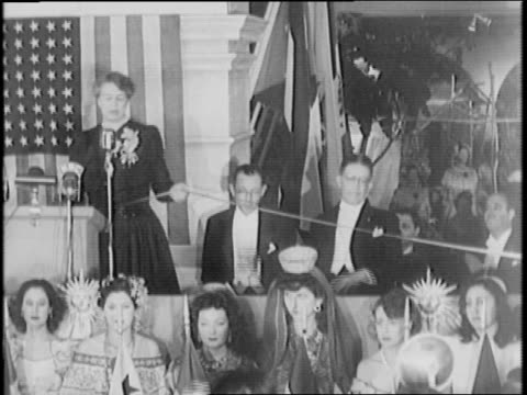 nelson rockefeller gives a speech inside macy store / eleanor roosevelt opens gate of the latin american fair in new york city / fairgoers are shown... - sombrero stock videos & royalty-free footage
