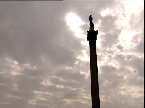 nelson's column against dramatic sky sunlight breaking through - nelson's column stock videos & royalty-free footage