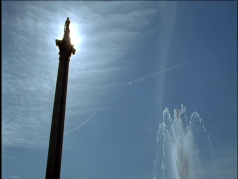 nelson's column and fountain trafalgar square london - nelson's column stock videos & royalty-free footage