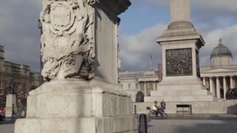 nelson's column and red bus, trafalgar square, westminster, london, england, uk - male likeness stock videos & royalty-free footage