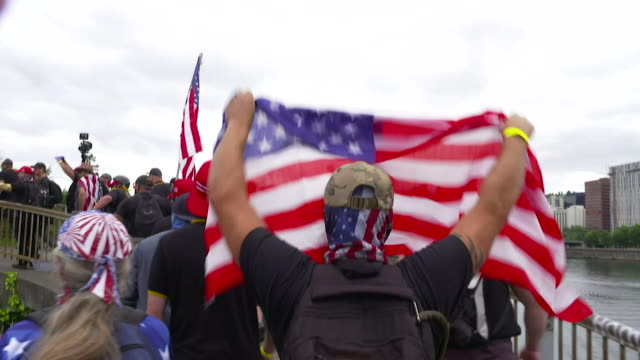 neo-fascist and white supremacy rally held in portland, oregan, usa flags being waved and white power symbols given - prejudice stock videos & royalty-free footage