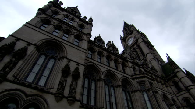 Neo-Gothic architecture characterizes the Manchester Town Hall. Available in HD.