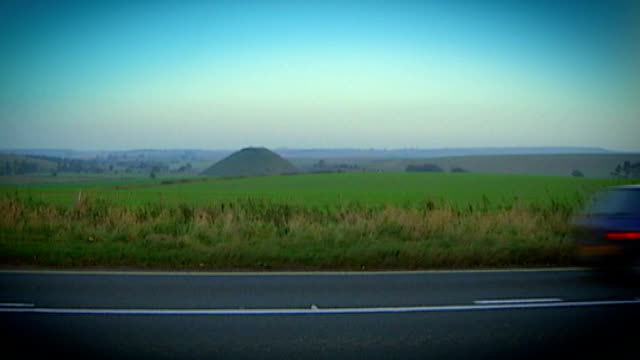 neolithic mound silbury hill saved by engineers; england: wiltshire: avebury: ext graphicised seq montage shots of silbury hill with rubble and... - avebury stock videos & royalty-free footage