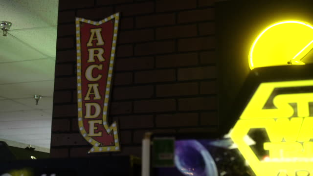neon arcade sign on wall - disney stock videos & royalty-free footage