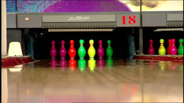 neon bowling ball toward neon pins - bowling ball stock videos & royalty-free footage