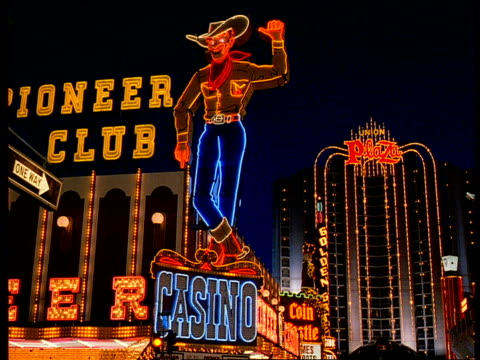 A Neon Cowboy Sign Glows Above The Pioneer Club Casino On Fremont