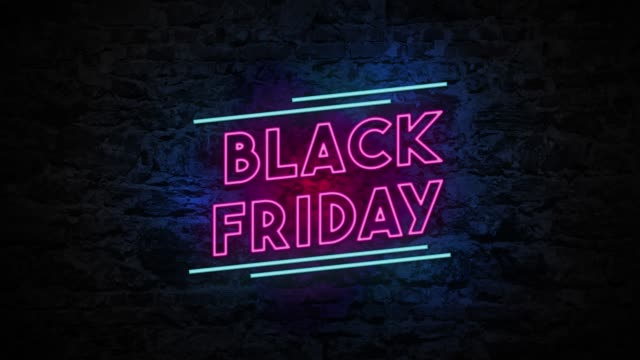 4k neon light black friday animation on the brick wall - black friday stock videos & royalty-free footage