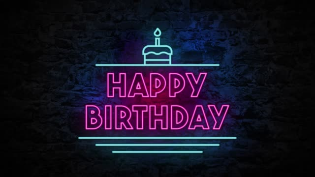 4k neon light happy birthday animation on the brick wall - compleanno video stock e b–roll