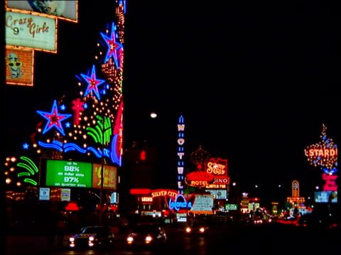 neon lights advertise las vegas hotels and casinos. - 1993 stock videos and b-roll footage